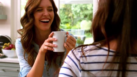 śmiech : Friends holding a cup of tea while laughing Wideo