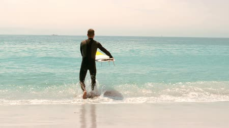 surf : Man with surfboard running in the water