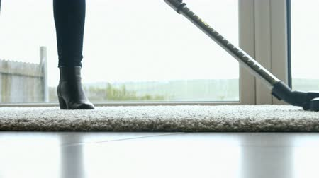 cleaning products : Woman using the vacuum cleaner for the carpet Stock Footage