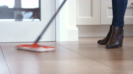 cleaning products : Woman using the mop for cleaning the floor Stock Footage