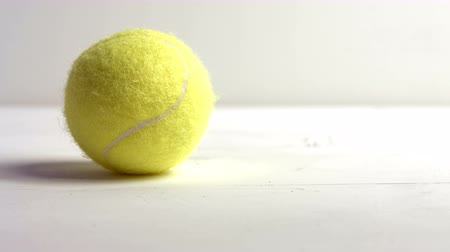 tennis game : Close up of tennis ball on white background Stock Footage