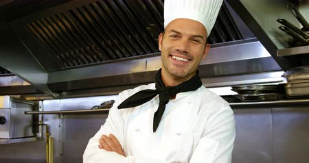 mutfak : Handsome chef crossing his arms in a restaurant kitchen