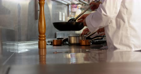 culinary : Two chefs cooking and working in a restaurant kitchen Stock Footage