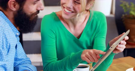 hipster : Hipster couple using tablet in cafe Stock Footage