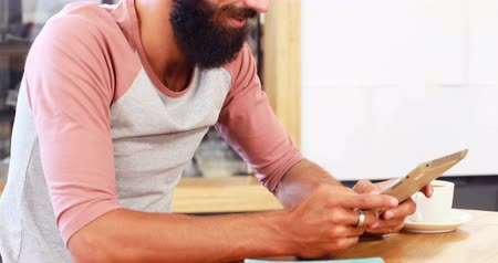 hipster : Hipster man using tablet in cafe Stock Footage