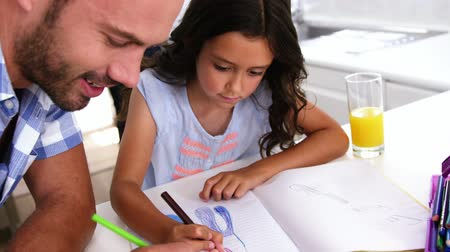 home life : A family is drawing together at home Stock Footage