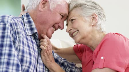 guy home : Happy senior couple looking each other at home
