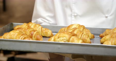 gourmet : Cook gourmet is cooking croissants in a restaurant