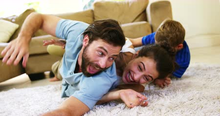 halı : Happy family playing on the carpet together at home