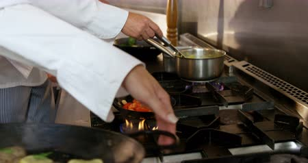 prepare food : Two chefs preparing food in the kitchen Stock Footage