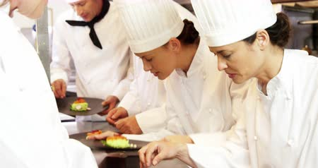 prepare food : Team of chef preparing food and working together in the kitchen