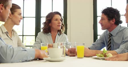 talk : Business people talking together at restaurant Stock Footage
