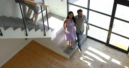 schody : Couples doing down the stairs at home Wideo