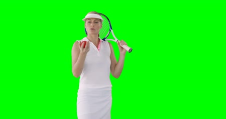 tennis whites : Portrait of woman tennis player is concentrating for a match against a green screen