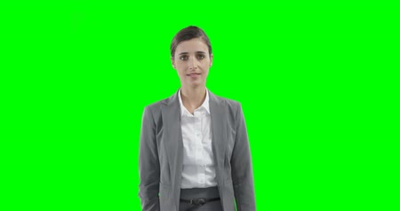 presleme : Businesswoman using a virtual touchscreen against a green background 4k
