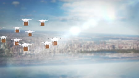 доставлять : Digital image of drones holding cardboard boxes and flying against cityscape Стоковые видеозаписи