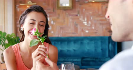 öneri : Man offering a rose to a woman in restaurant 4k