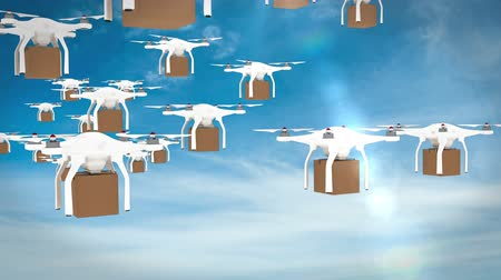 доставлять : Digital image of drones holding cardboard boxes and flying against blue sky Стоковые видеозаписи