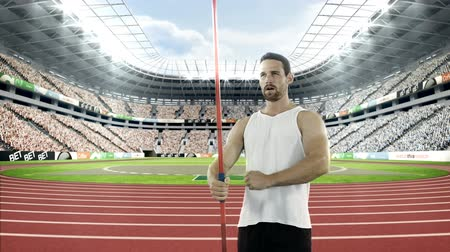 javelin : Male athlete warming up before javelin throw in the a stadium Stock Footage