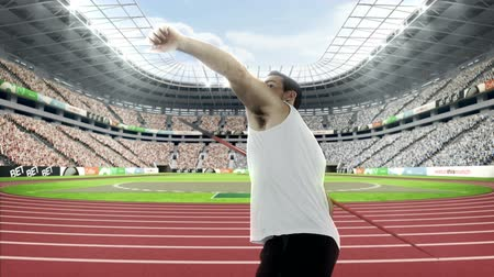 javelin : Male athlete throwing the javelin in the a stadium Stock Footage