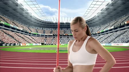 javelin : Female athlete standing with javelin throw in a stadium