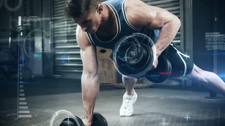 atlet : Slow motion of athlete performing push ups with dumbbell against the animated background