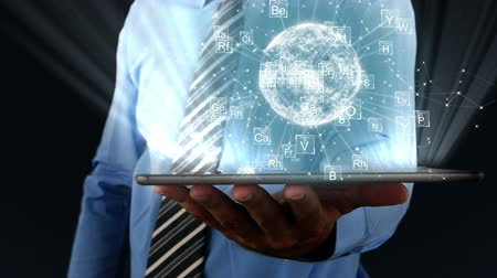 tridimensional : Mid section of businessman using digital tablet against black background