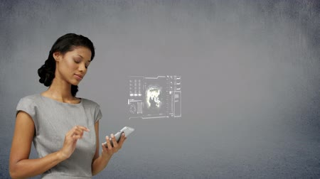 de brainstorming : Businesswoman touching mobile phone with virtual digital interface against grey background Vídeos