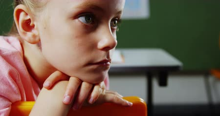 displeasure : Slow motion of upset girl sitting in classroom at school 4k Stock Footage