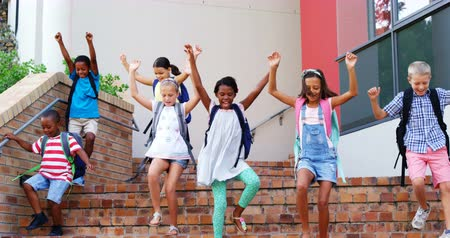 okula geri : Slow motion of school kids getting down from staircase at school 4k