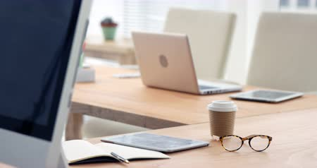 organizer : Spectacle, disposable coffee cup, laptop, computer and digital tablet on desk in office 4k