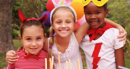 kostüm : Kids in various costumes celebrating birthday in the park 4k Stok Video