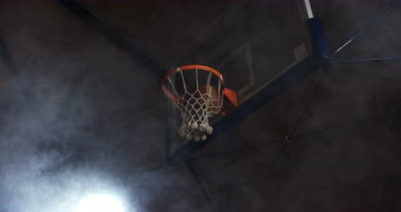 abroncs : Close-up of basketball going through hoop in basketball court 4k Stock mozgókép
