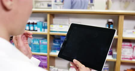 dispensary : Pharmacist using digital tablet in pharmacy