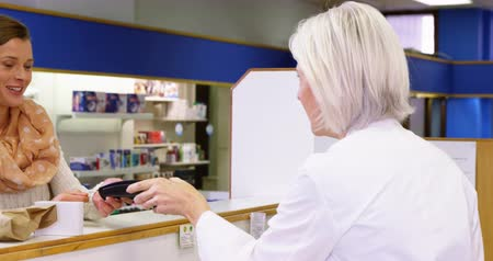 dispensary : Customer entering pin code on payment terminal in pharmacy