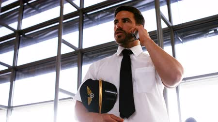 aircrew : Pilot talking on mobile phone at airport