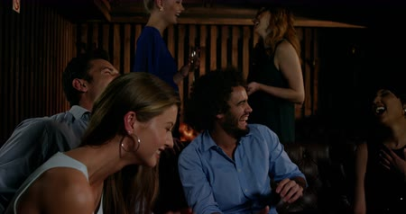 паб : Slow motion of smiling friends having fun in bar 4k
