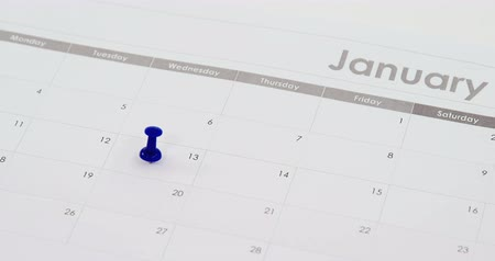 rajzszeg : Close-up of blue push pin marked on calendar 4k Stock mozgókép