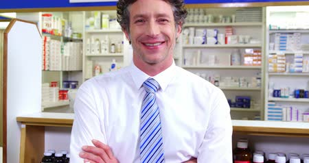 dispensary : Portrait of pharmacist standing with arms crossed in pharmacy 4k