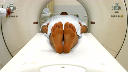 radiation therapy : A male patient lying on an mri machine at the hospital 4k Stock Footage