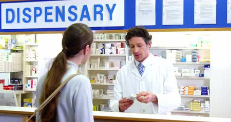 dispensary : Pharmacist assisting the medicine to customer in pharmacy 4k Stock Footage