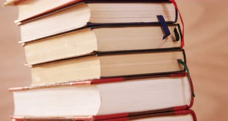 záložka : Close-up of various books stack on desk 4k