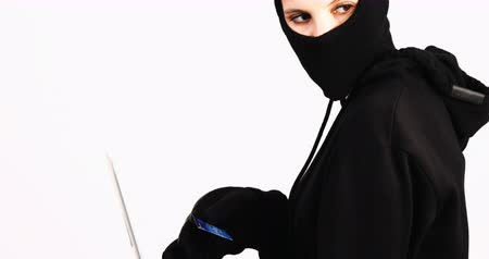 ladrão : Female burglar doing online shopping with laptop and credit card on white background 4k Vídeos