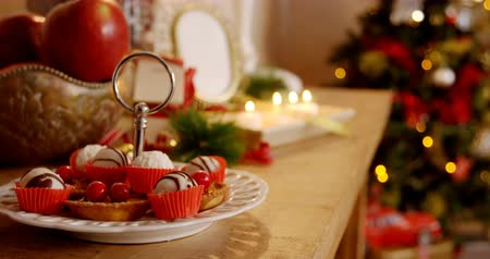 desszertek : Various christmas desserts and decorations on wooden table during christmas time 4k