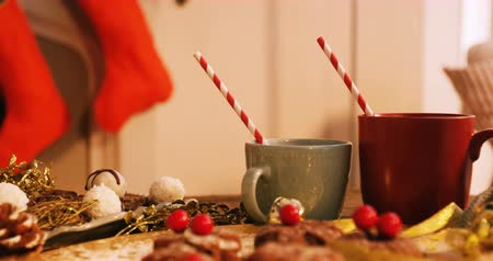 ünnepies : Close-up of various christmas desserts and mug on wooden table 4k