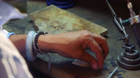carreira : Close-up of craftswoman working in workshop 4k Stock Footage