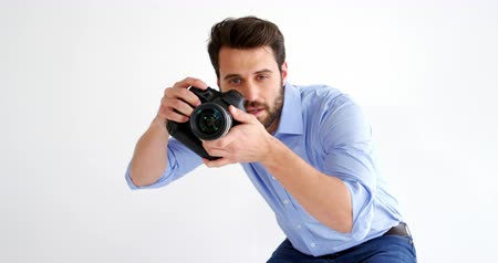 fényképész : Photographer taking photo with professional digital camera in studio 4k Stock mozgókép