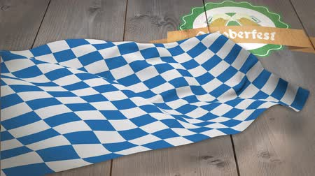 bavarian flag : Digitally generated of oktoberfest flag waving on wooden plank Stock Footage
