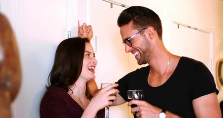 miłość : Couple interacting with eachother while drinking red wine at home