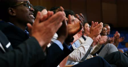 Business executives applauding in a business meeting at conference center Stock Footage